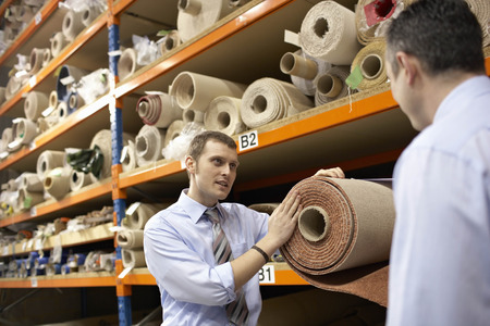 30 s: Two businessmen in warehouse Stock Photo