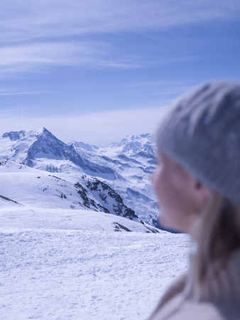 woman relaxing on sunny mountain top Stock Photo