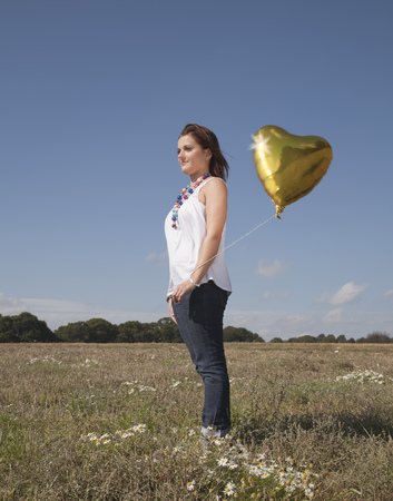 Girl with heart shaped balloon