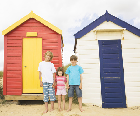 Children in front of beach huts