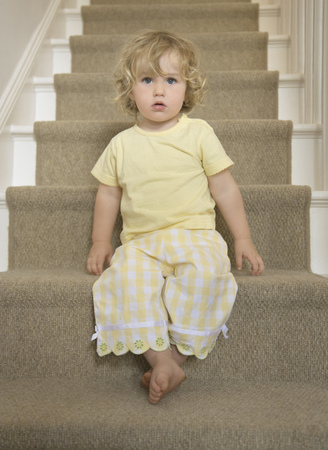 trusted: Girl sitting on stairs Stock Photo