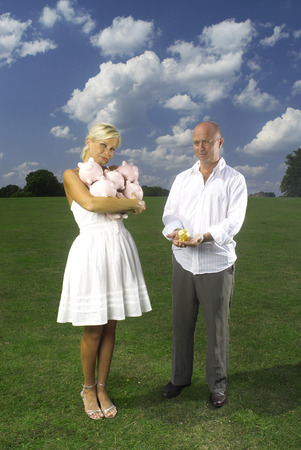 couple holding piggy banks