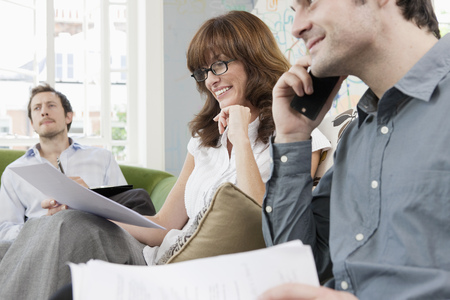 People working at casual office Stock Photo