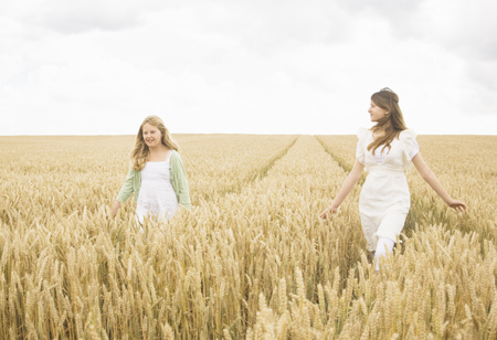 remoteness: Girls in wheat Field Stock Photo