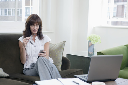 Business women working on mobile phone Stock Photo