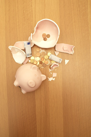 smashed piggy bank and money Stock Photo