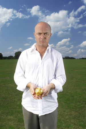 man holding small piggy bank Stock Photo