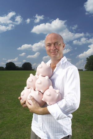 man holding piggy banks Stock Photo