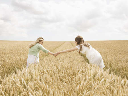 Girls in wheat Field Imagens