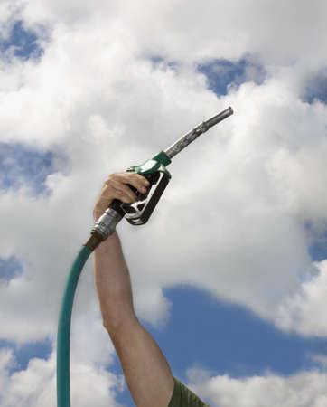 Mans arm with petrol pump