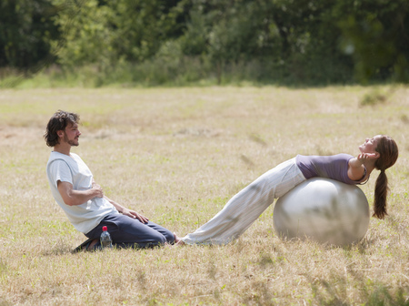 couple with yoga ball stretching Stock Photo