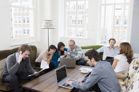 People working at casual office