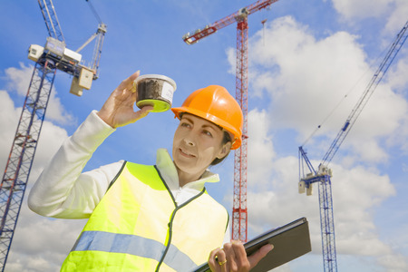 Woman viewing sample at building site Standard-Bild