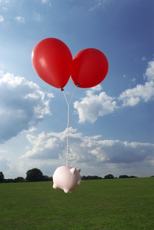 monies: piggy bank tied to balloons