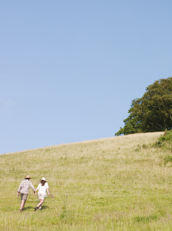 Man and woman walking up hill