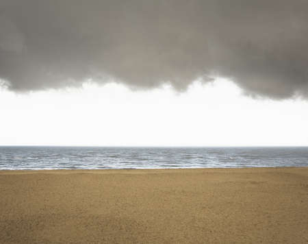 stormy waters: Beach with brooding sky Stock Photo