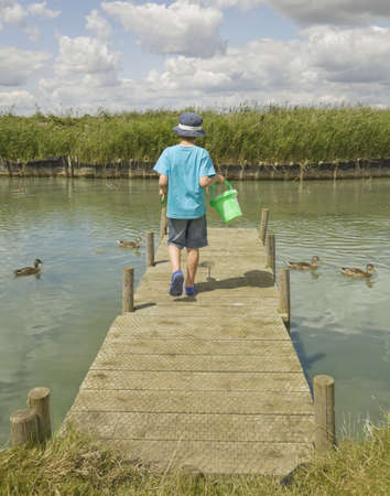 migrated: Boy walking on jetty