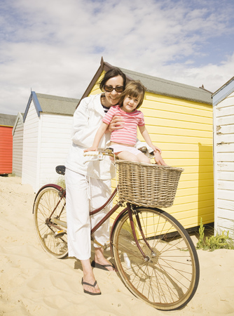 Woman and girl with bike