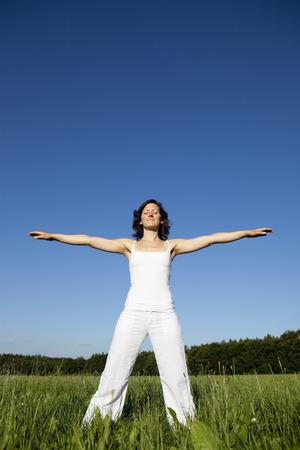 Woman Doing Yoga In Meadow Stock Photo - 86035268