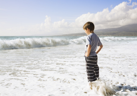 Boy looking out to sea