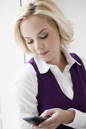 Woman looking at phone Stock Photo