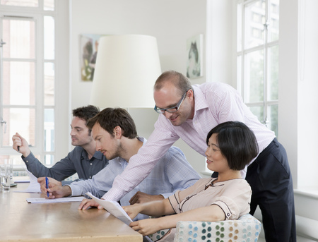 Group of people at a conference table