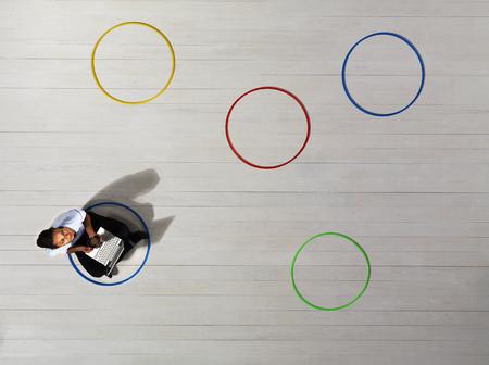 Business women sitting in circle Фото со стока