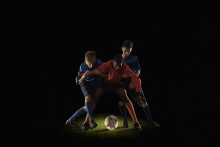 Footballers competing for ball Banco de Imagens - 86035279