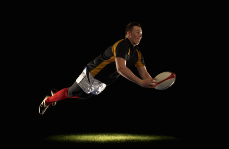 Rugby player diving an throwing ball Banco de Imagens - 86035280