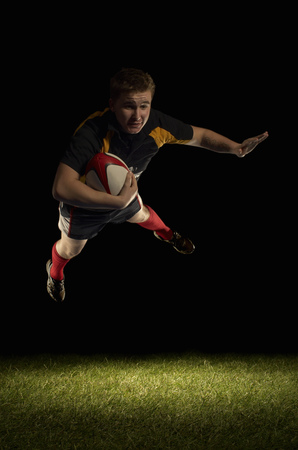 scored: Rugby player mid air with ball