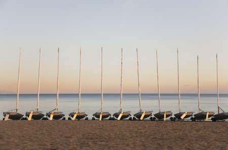 conforms: Sail boats on a beach