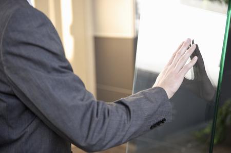 Businessman using touchscreen Stock Photo