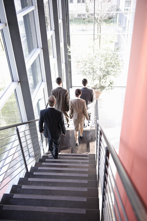 conforms: Executives walking downstairs Stock Photo