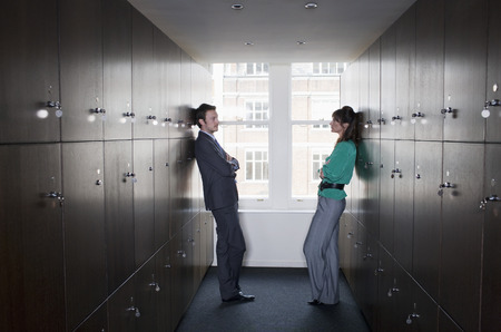 Business couple in locker room Stock Photo - 85954392