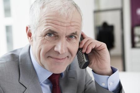 Phoning man looking at camera Stock Photo