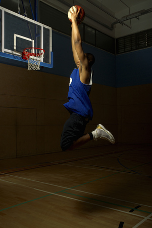 Basketball player jumping to hoop Stock Photo