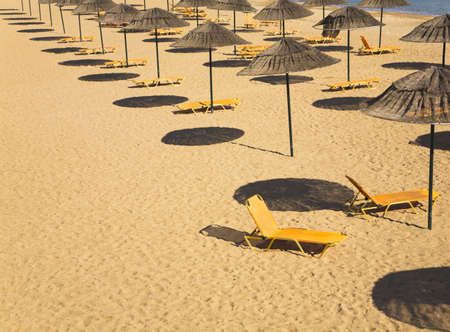 conforms: Sunloungers on Beach Stock Photo