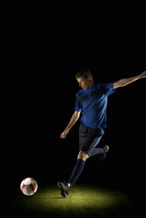 Footballer about to kick a ball