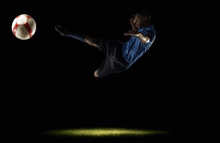 Footballer doing scissors kick Banco de Imagens - 85899751