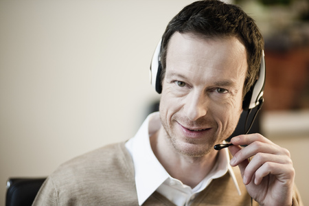 Man with headset looking at camera
