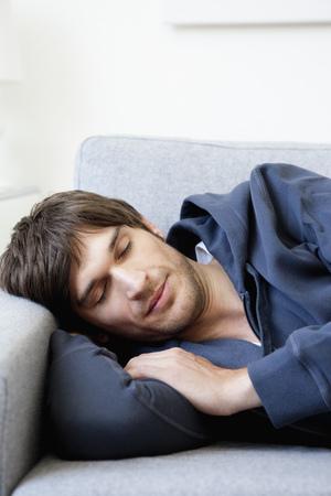 Man sleeping on sofa Stok Fotoğraf