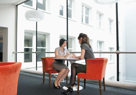 Female couple working at a restaurant Banco de Imagens