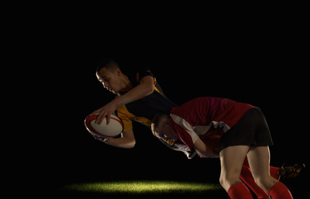 Rugby player being tackled