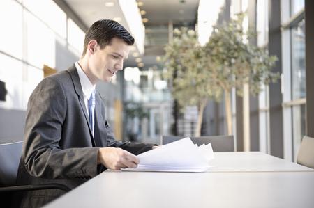 Businessman looking at blueprint