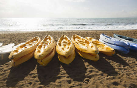conforms: Canoes on Beach Stock Photo