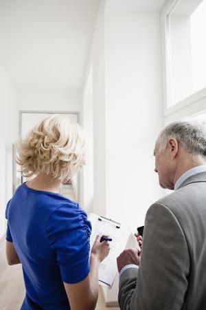 Business people meeting in corridor
