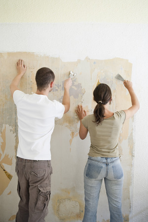 Young couple renovating Banco de Imagens