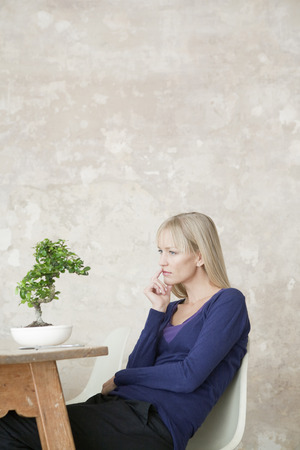 woman with bonsai Stock Photo