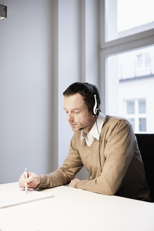 Man with headset in office