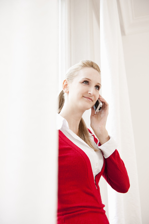 A woman talking on the telephone, smiling
